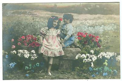 Junge, Mädchen, Blumen, col. Foto-AK, um 1920