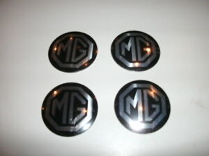 MGB-SET-4-WHEEL-CENTER-CAP-BADGE-HUBCAPS-HUB-CAPS-68-80