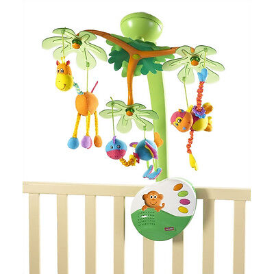 The Tiny Love Sweet Island Dreams Mobile consists of a vivid green palm  tree hanging over the crib with three jungle animals (giraffe, bird, ... - Top 10 Crib Mobiles Of 2013 EBay