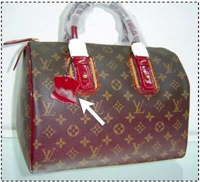 5a75192dec How to Tell a Bag Is Fake in 30 Seconds Flat   Who What Wear