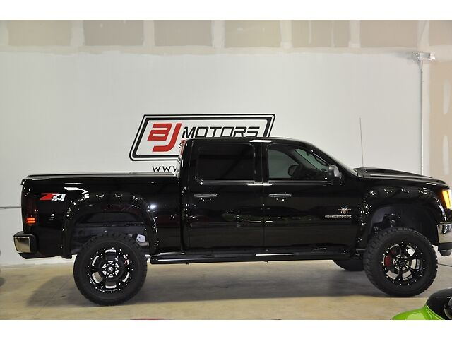 GMC Black Widow Edition http://www.sportfishermen.com/board/f649/2013-gmc-sierra-1500-black-widow-edition-4-x-4-only-5k-miles-3509793.html