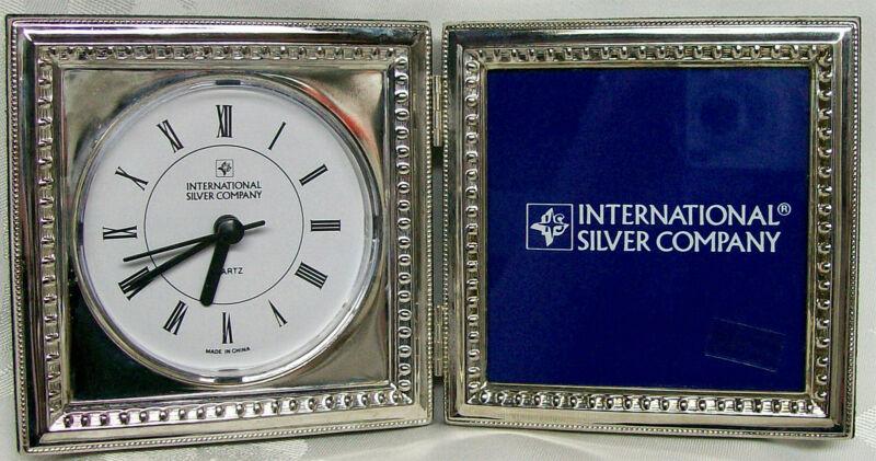 INTERNATIONAL SILVERPLATE PICTURE FRAME QUARTZ CLOCK