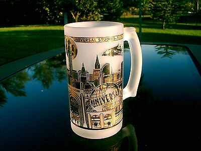 """UNIVERSAL PICTURES 5.5"""" TALL FROSTED GLASS MUG VINTAGE ITEM DETAILED GOLD CITY"""