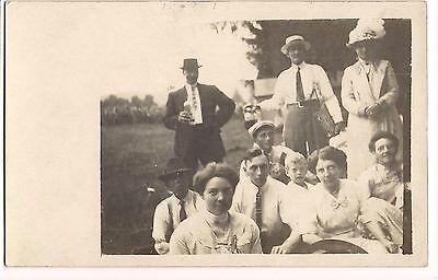 RPPC  GROUP PHOTO Men & Women Family PARTY Alcohol Bottles Postcard Real Pic ()