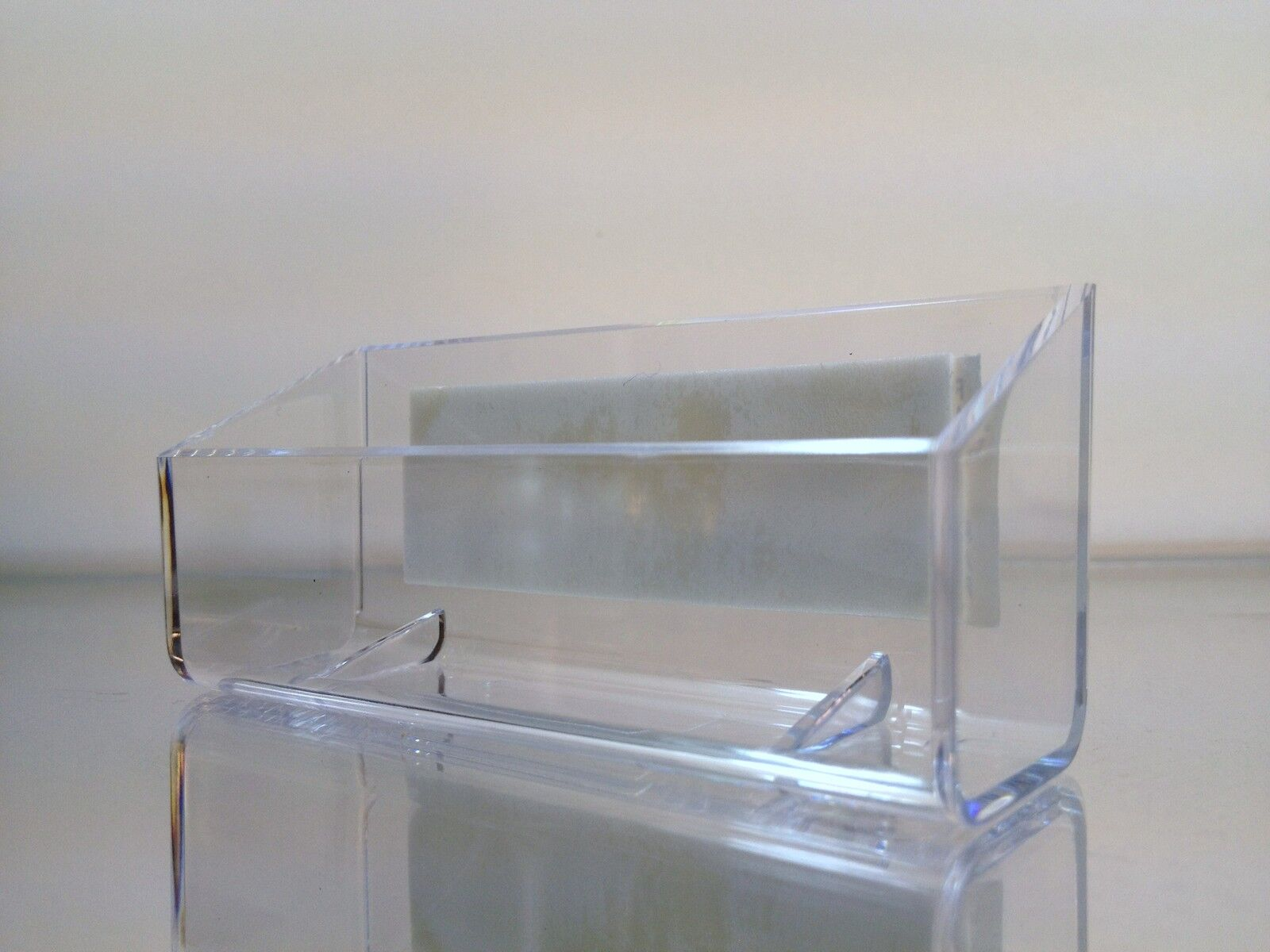 Clear plastic business card holder display with an ADDHESIVE STRIP ...
