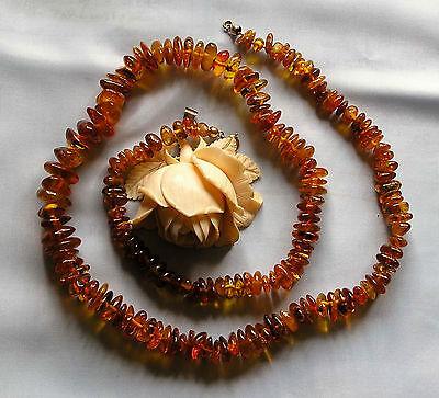 Alte Bernstein Halskette aus honigfarbenen Cabonchon, Länge 73 cm