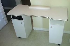 Manicure table with 8 storage cubbies