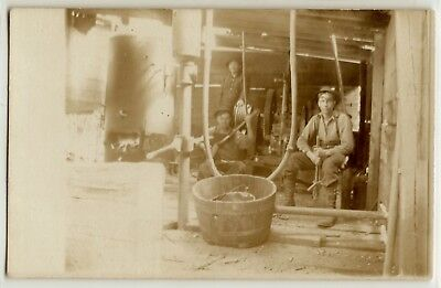 Three men in a machine shop, steam donkey? c. 1915; real photo postcard RPPC for sale  Shipping to Canada