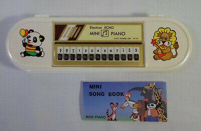 ELECTRON ECHO VTG 80's MINI PIANO + SONG BOOK IN WHITE PENCI