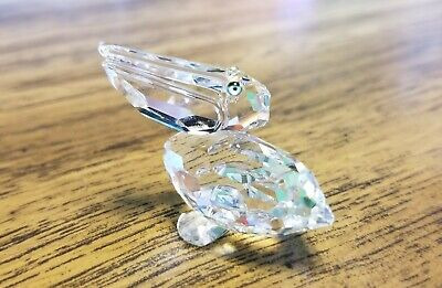 Swarovski Crystal Pelican Figurine with Green Colored Eyes 7679, Box, Logo, COA