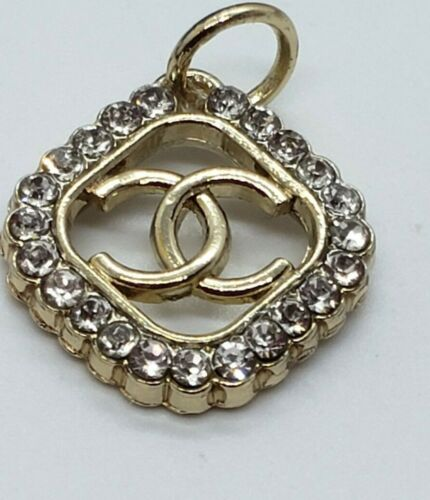 1 gold toned Chanel zip pull with rhinestones, small, view all photos
