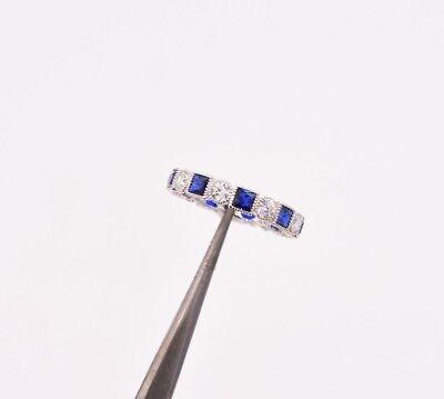 - Princess Cut Sapphire & Round CZ Rhodium Over Silver Bezel Set Band Ring 925