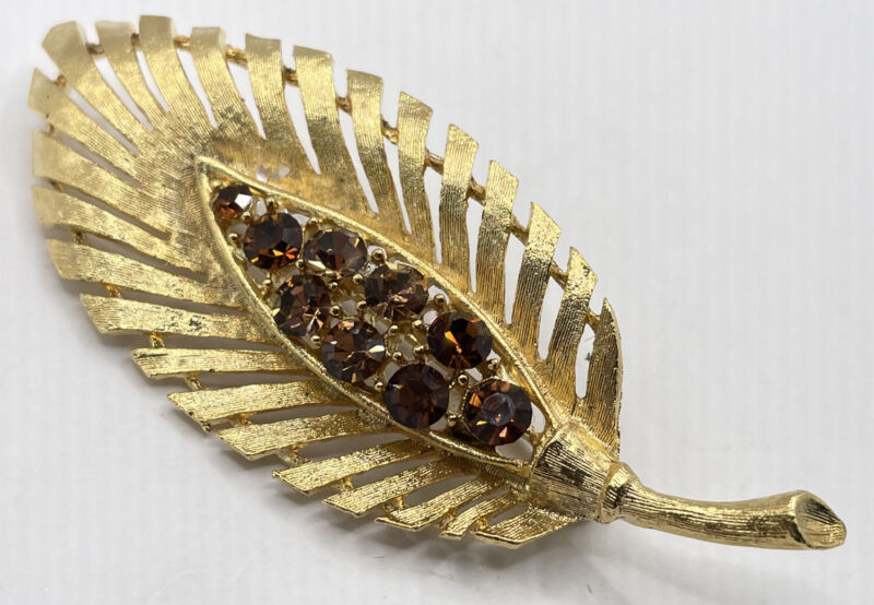 BRUSHED GOLD TONE LEAF PIN BROOCH WITH AMBER COLORED RHINESTONES