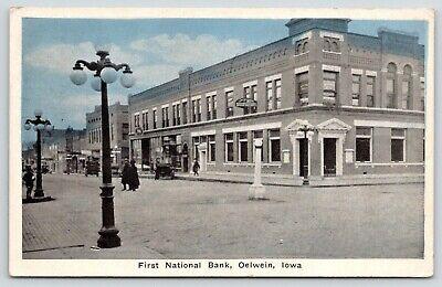 Oelwein Iowa~First National Bank Corner~Businesses Down Street~Autos~1929 PC ()