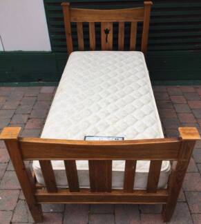 Excellent wooden frame single bed with King Koil mattress