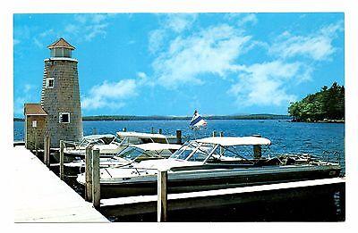 Lake Winnipesaukee New Hampshire Postcard Boats Lighthouse Dock Vintage
