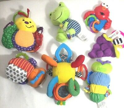 7 Piece Lot of Baby Toys Rattles Teethers Squishies