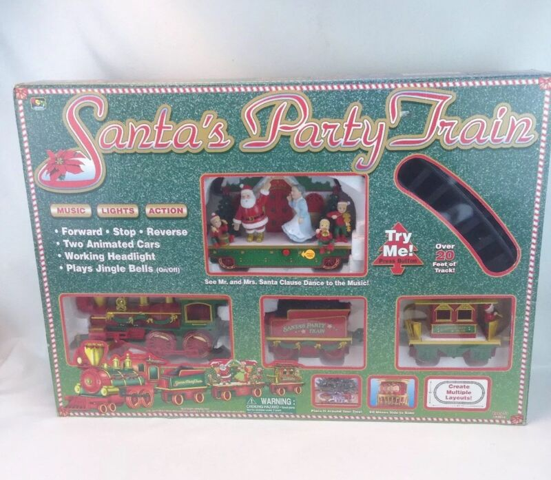ANIMATED MUSICAL LOCOMOTIVE TRAIN 2001 CHRISTMAS PARTY SANTA CLAUS NEW IN BOX