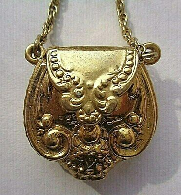 1928 gold tone purse pendant/locket with chain
