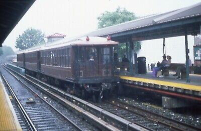 NYCTA Transit subway slide. Brooklyn Union elevated wood gate cars in downpour