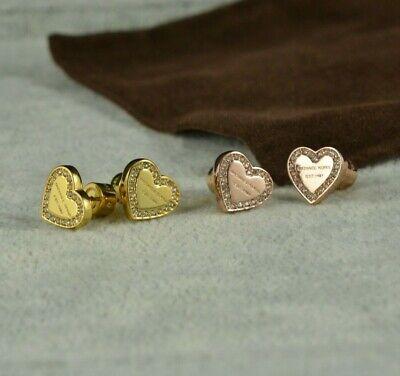 Michael Kors rose or gold tone heart logo stud earrings