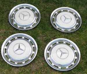 Mercedes hubcap hubcaps set of 4 stainless chrome mercedes for Mercedes benz hubcaps