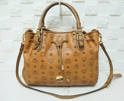 100% Authentic MCM Visetos Studded Cognac Large 2 Way Drawstring Shoulder Bag