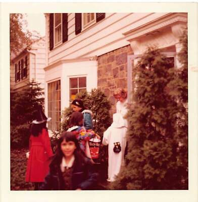WOMAN SMOKES HANDS OUT CANDY TRICK OR TREATING KIDS HALLOWEEN COSTUMES VTG PHOTO - Halloween Candy Hand Out