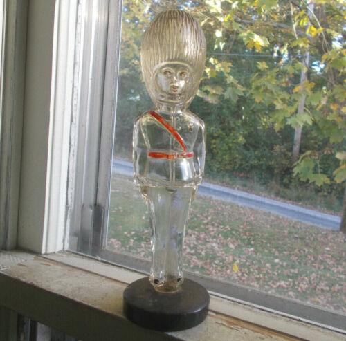 VINTAGE BRITISH ROYAL GUARD FIGURAL GLASS COLOGNE BOTTLE WITH METAL BASE