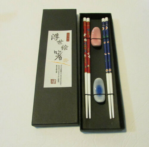 set of 2 chopsticks red and blue wth floral design and ceramic rest