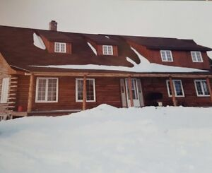 Beautiful log home on 78 acres minutes from Moncton