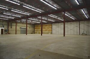 * LARGE 12,500 SQFT WAREHOUSE SPACE WITH INDOOR LOADING DOCK *