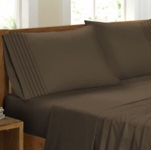 Brand new king size 4 Pieces sheet set ( taupe and chocolate)
