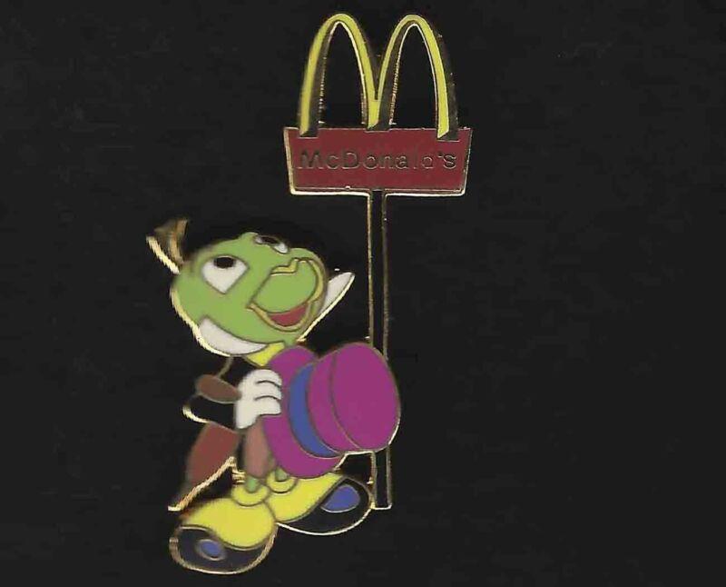 Jiminy Cricket Holding Pink Hat Looking up at McDonald Sign - LE200