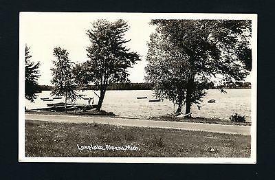 Alpena Michigan MI RPPC 1947 Long Lake Shore Drive, Wooden Boats on Lake Dock  )