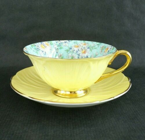 Vintage SHELLEY Yellow OLEANDER Shape Cup & Saucer w/ MARGUERITE Pattern & Gold
