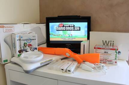 Wii Bundle Including Fit Board - Console, Accessories, Games