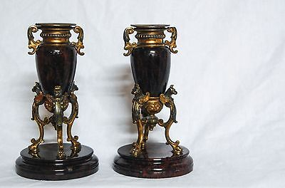 A PAIR OF EARLY VICTORIAN SERPENTINE & FIRE GILT CANDLESTICK HOLDERS