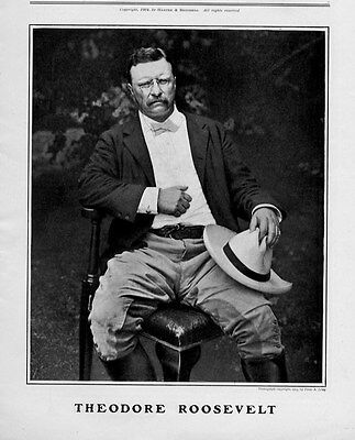 PRESIDENT THEODORE ROOSEVELT SITTING ON HIS CHAIR HOLDING HAT BOOTS GLASSES