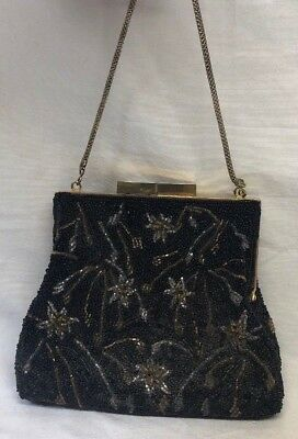 1920s Handbags, Purses, and Shopping Bag Styles 1920's Black Beaded Purse w/ Brass Handle and Silk Insides $39.95 AT vintagedancer.com