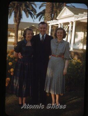1950s red border kodachrome Photo slide man & ladies Los Angeles County fashion