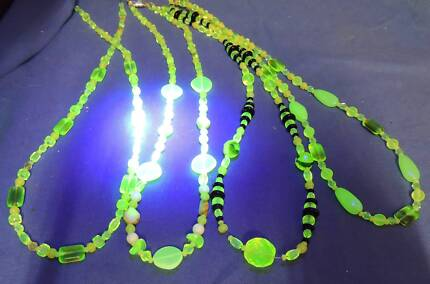4 uranium glass necklaces from $35-$40 each  one had green glass