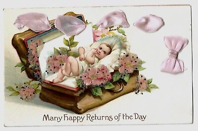 NICE Early Postcard w/add-on pink ribbon & Glitter:  Baby in suitcase bed. EXC.
