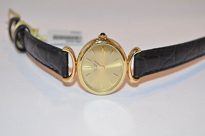 W213- Concord Ladies Oval Face Yellow Gold Quartz Watch w/ Black Leather Band  ()
