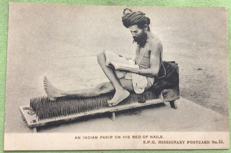 Indian Fakir on his Bed of Nails Vintage Postcard