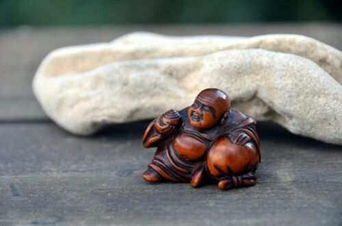 Antique Japanese netsuke Hotei resting on  bag of fortune Edo period really used