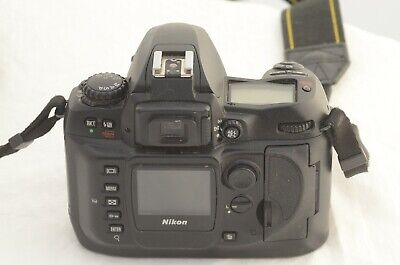 Nikon D100- body only- fires but does have fault.