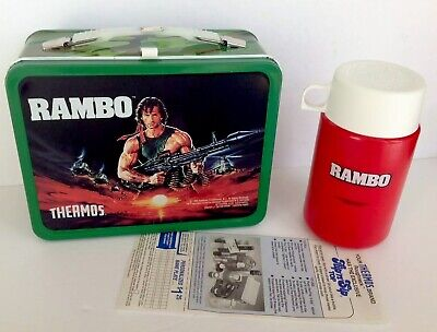 VINTAGE NEW UNUSED MINT 1985 RAMBO LUNCHBOX BY KST WITH THERMOS & TAGS.