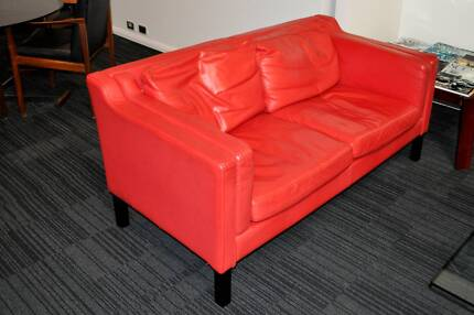Red two seater leather sofa