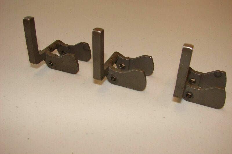 """Lot of 16, 1-1/4"""" high, offset, pusher lugs for flow wrappers."""